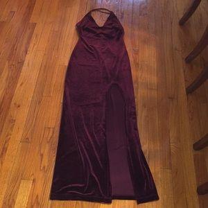 Tight fitting long red velvet dress with slit